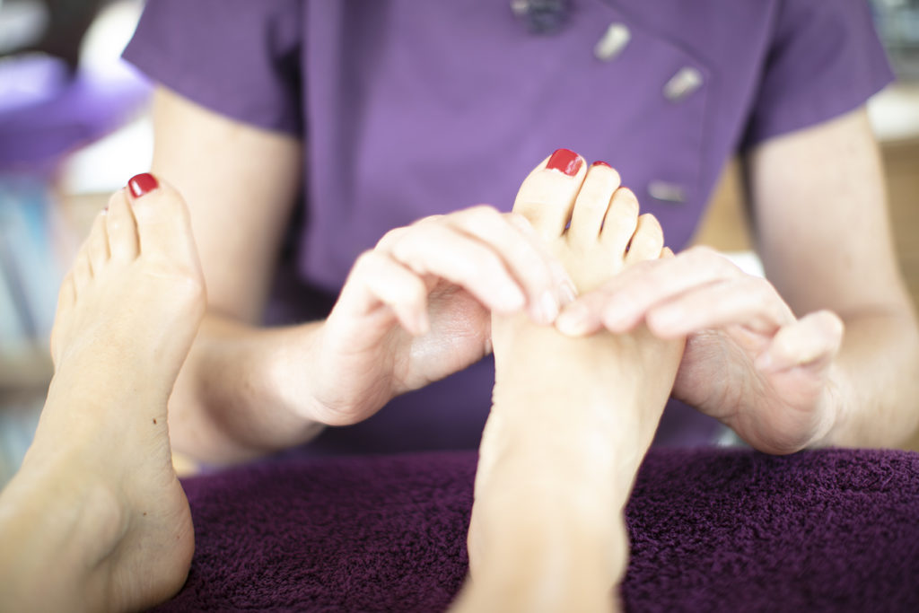 Reflexologist giving reflexology